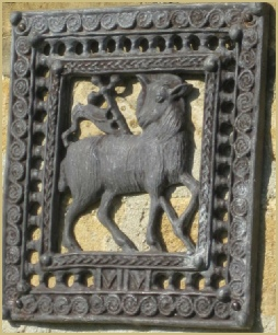 The lamb and flag: find the original carving at Cotswold Woollen Weavers in Filkins