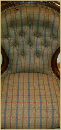A walnut-framed button back covered in Cotswold Woollen Weavers' famous Gloucestershire check