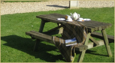 Cotswold Woollen Weavers' picnic area on a warm summer evening